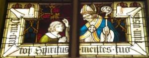 Bischof firmt einen Jugendlichen